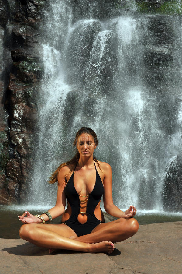 Download Beautiful Girl Wearing Black One Piece Swimsuit Meditating In Lotus Yoga Pose Stock Photo - Image of relax, attractive: 33310444