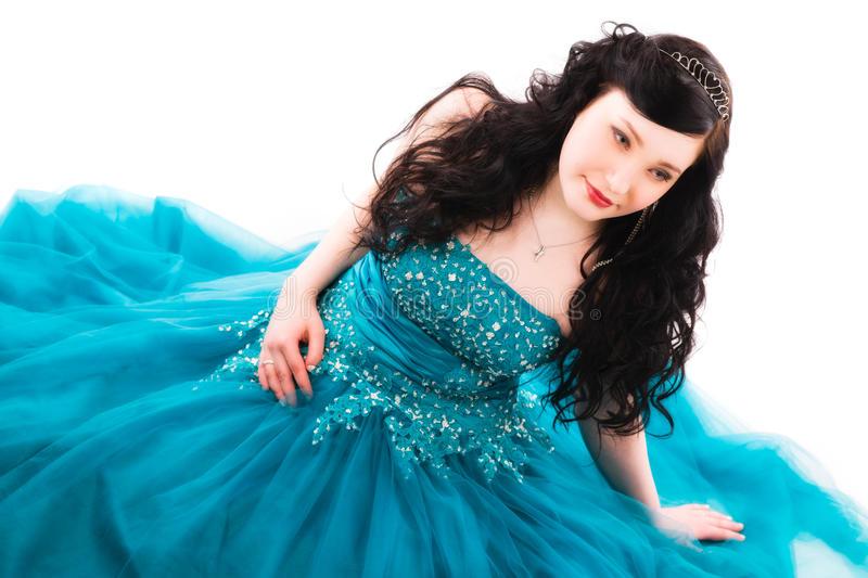 Prom dress. Beautiful girl wearing a prom dress, she is sitting on the ground, horizon format royalty free stock photos