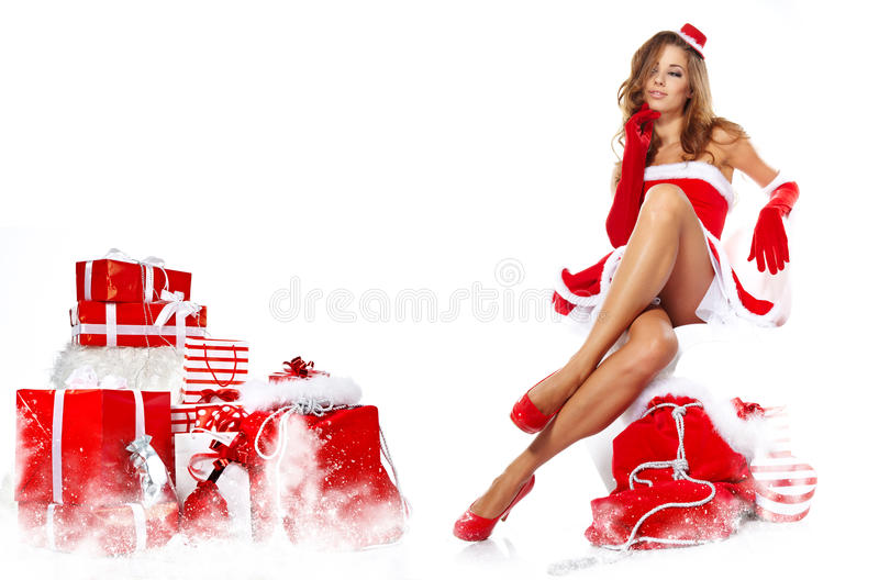Beautiful girl wearing santa claus clothes with christmas g royalty free stock images