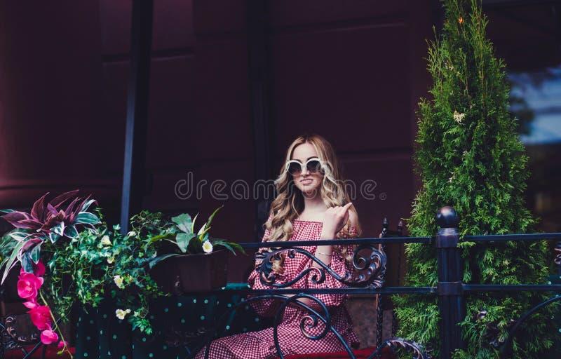 Beautiful girl wearing stylish sunglasses royalty free stock photo