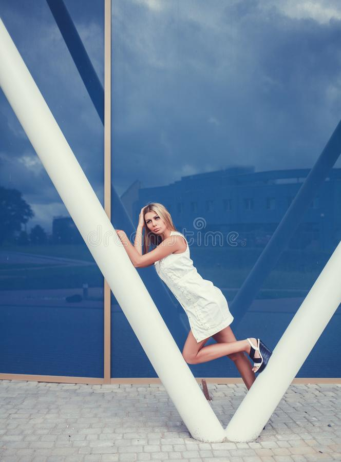 Beautiful girl wearing white dress stock photos