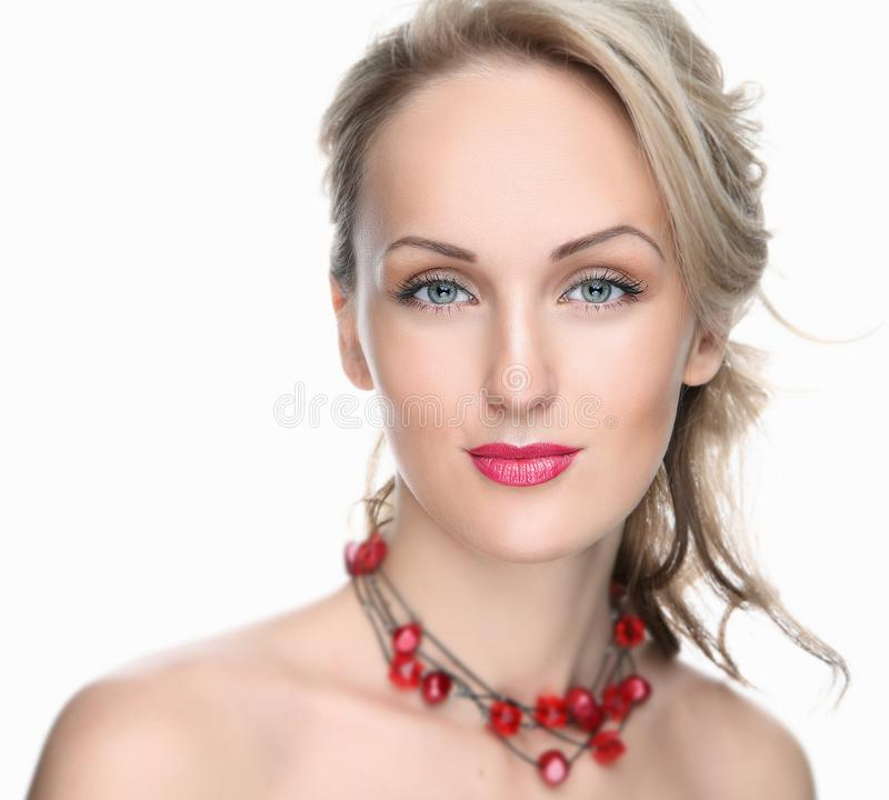 Beautiful girl on a white background with red lips and decoration royalty free stock photos