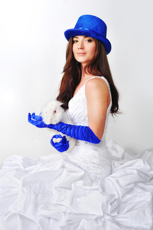 Beautiful girl in a white dress in a blue hat stock photo
