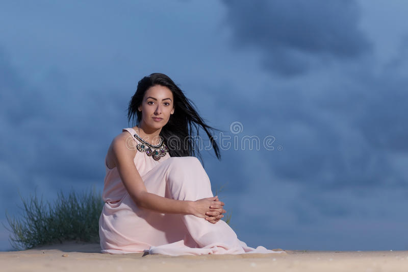 Beautiful girl with a white dress stock photos