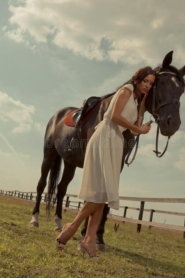 Download Beautiful Girl In A White Gown With Horse Stock Photo - Image: 22196650