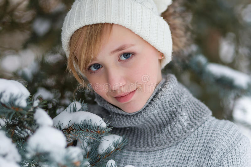 Download Beautiful Girl In A White Hat And Mittens In The Winter Snowy Fo Stock Image - Image: 83719925