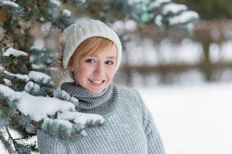 Download Beautiful Girl In A White Hat And Mittens In The Winter Snowy Fo Stock Photo - Image of model, blonde: 83720724