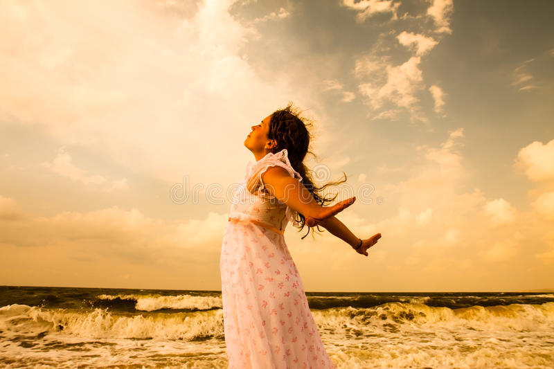 Beautiful girl in white on sunny beach. Freedom and peace concept royalty free stock photos