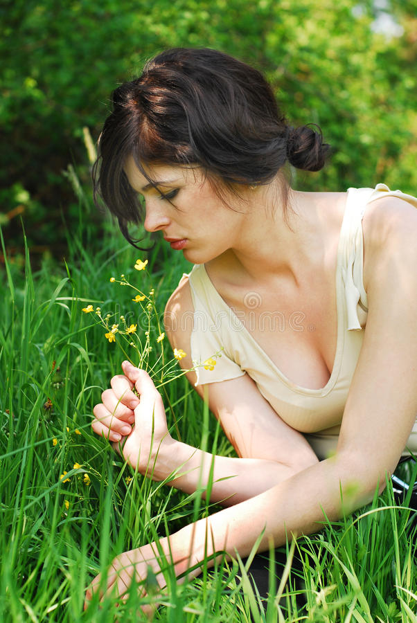 Beautiful girl with wild flowers royalty free stock image
