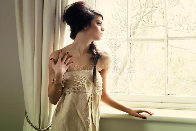 Download Beautiful girl by window stock image. Image of colour - 25310105