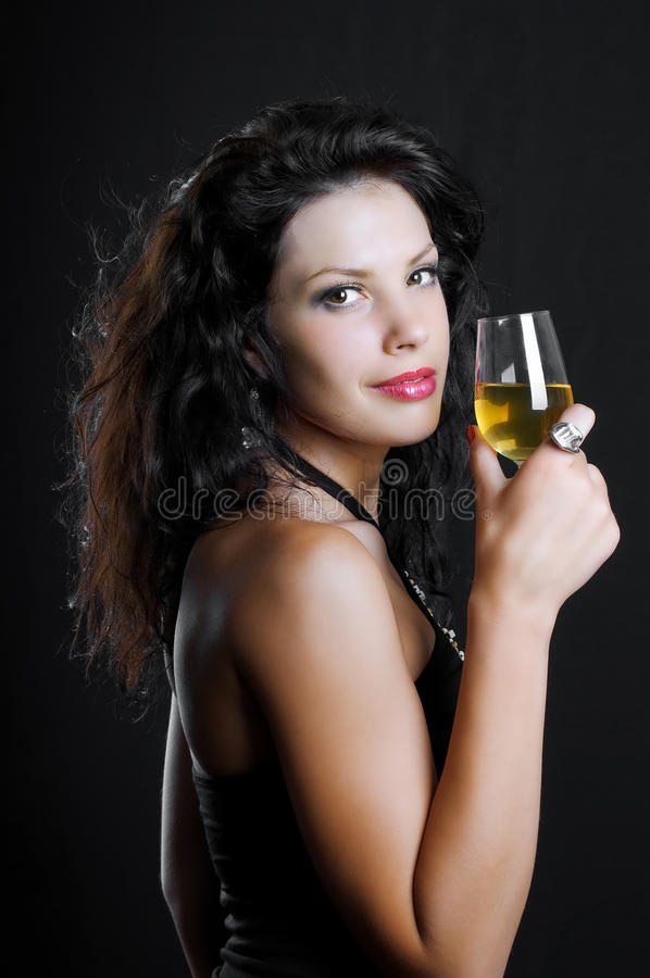 Beautiful girl with wine glass on black. Background royalty free stock photo