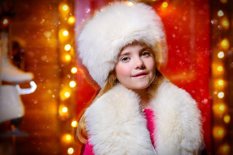 Beautiful girl in winter clothes royalty free stock image