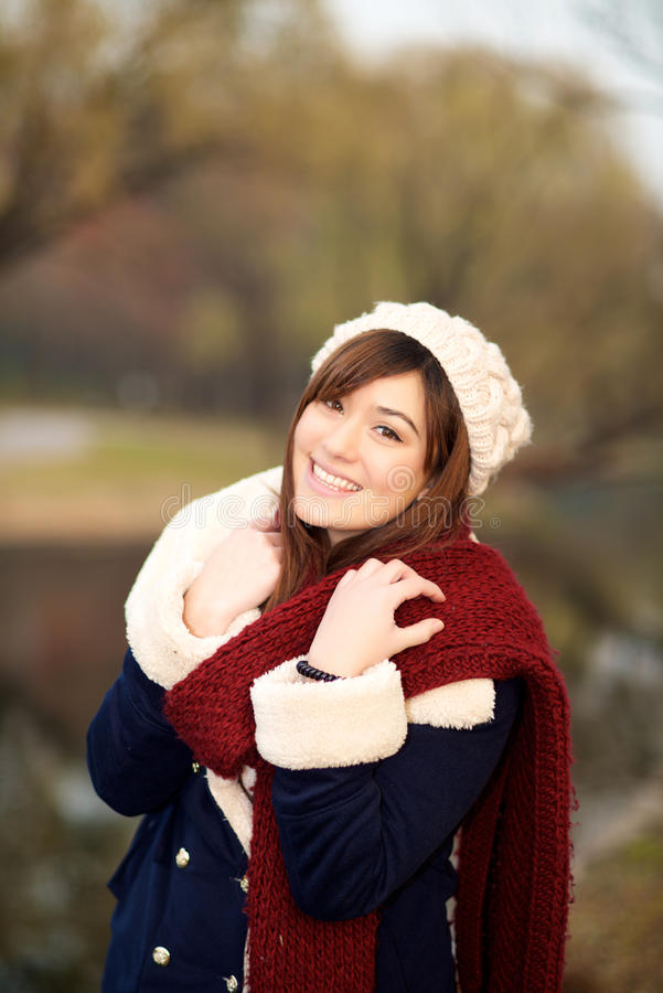 Beautiful girl in winter clothes smiling royalty free stock photography
