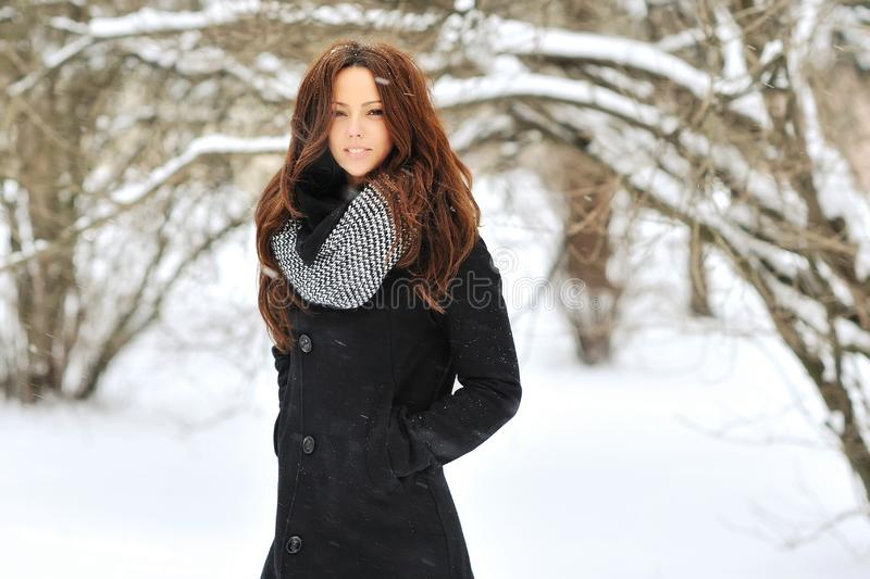 Beautiful girl in winter - outdoor fashion portrait royalty free stock photography