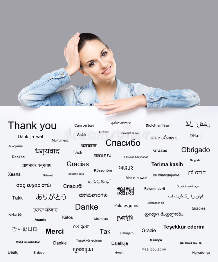 Free Beautiful Girl With A Banner Of World S Different Languages Royalty Free Stock Image - 62776006
