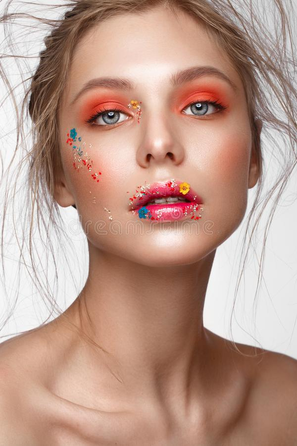 Free Beautiful Girl With Art Make-up And Flowers. Beauty Face. Stock Photo - 115216560