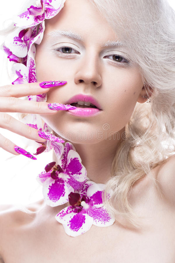 Free Beautiful Girl With Art Make-up, Flowers, Curls And Long Nails. Manicure Design. The Beauty Of The Face. Royalty Free Stock Images - 73637279