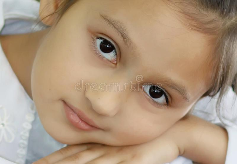 Beautiful girl 7 years old. Close-up portrait stock photos