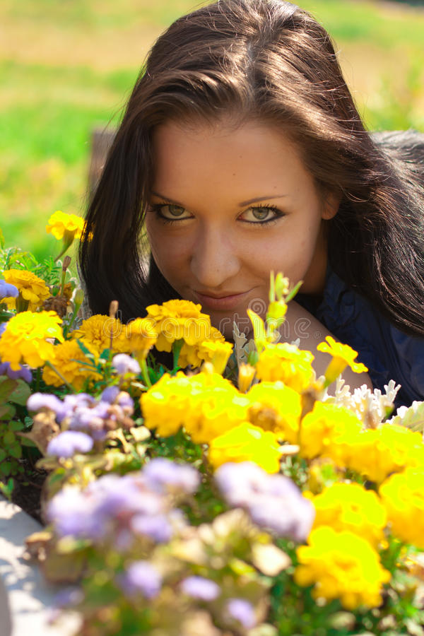 Beautiful girl with yellow flowers royalty free stock photos