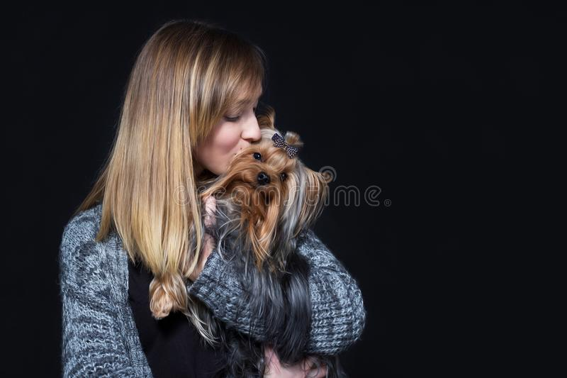 Beautiful girl with yorkshire terrier royalty free stock images