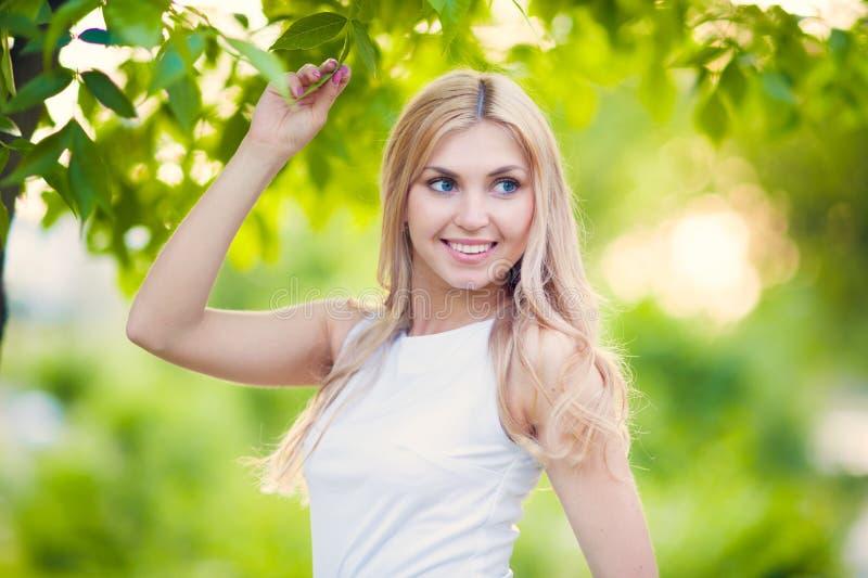 Beautiful girl. Beautiful Young happy Woman Outdoors in a long dress looking down stock photos