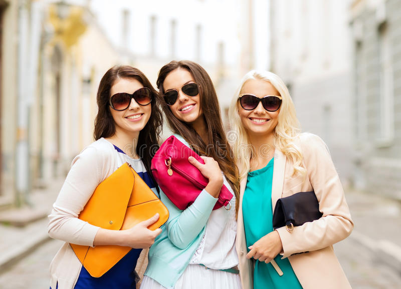 Beautiful girls with bags in the ctiy royalty free stock image