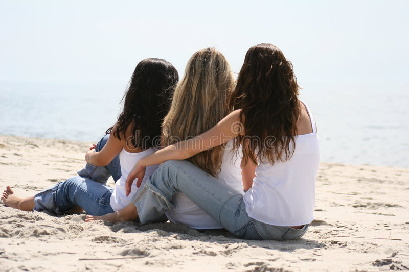 Beautiful girls on the beach royalty free stock photo