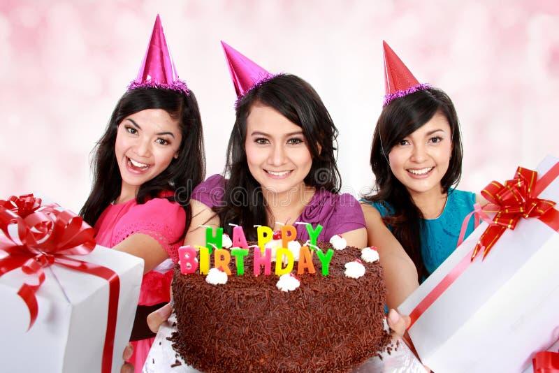 Beautiful girls celebrate birthday. Three young beautiful girls celebrate birthday stock photography
