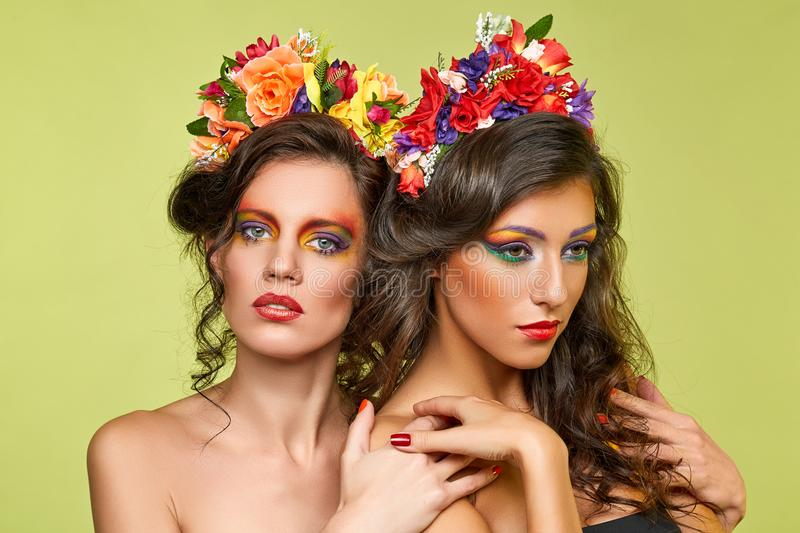 Beautiful girls with flower accessories royalty free stock photo