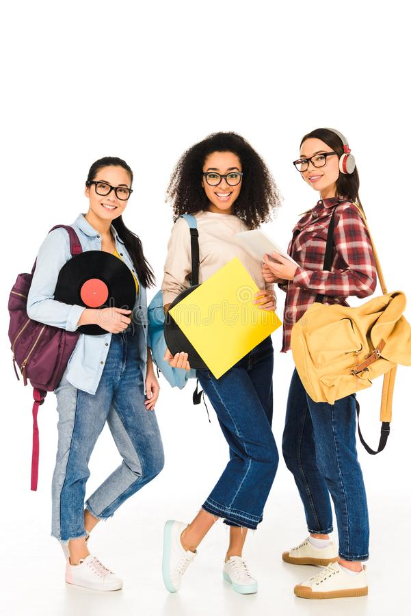 Beautiful girls in glasses with vinyl records  isolated. On white royalty free stock images