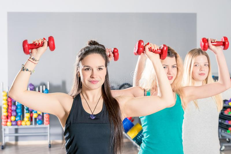 Beautiful girls in the gym train, group exercise royalty free stock images