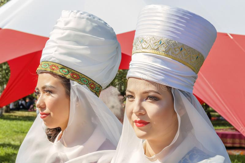 Beautiful girls in Kazakh national costumes on a sunny day. Portrait royalty free stock images
