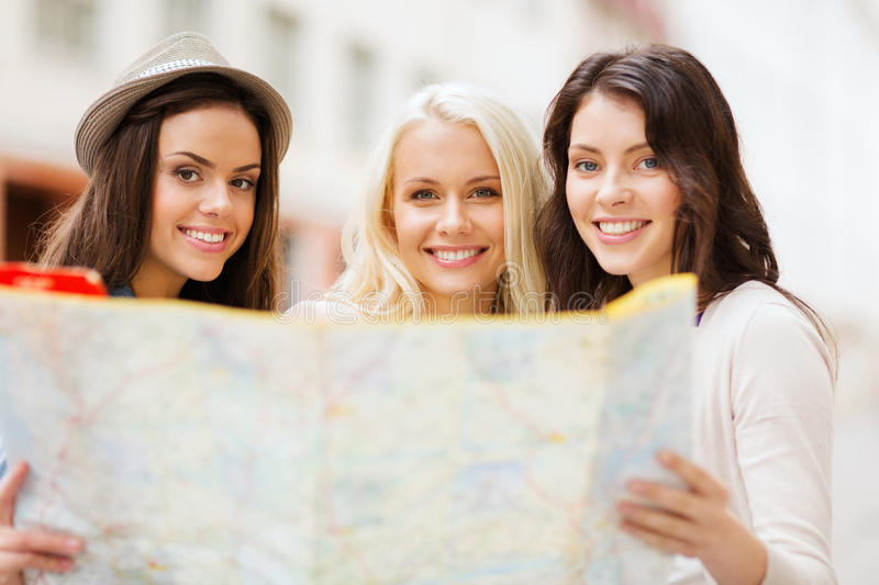 Download Beautiful Girls Looking Into Tourist Map In City Royalty Free Stock Images - Image: 33186479