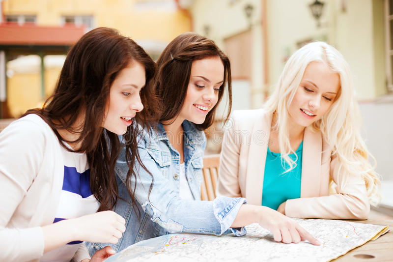 Download Beautiful Girls Looking Into Tourist Map In City Royalty Free Stock Photo - Image: 33186545