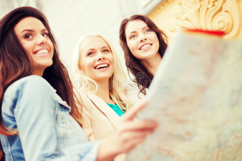 Download Beautiful Girls Looking Into Tourist Map In City Stock Image - Image of foreign, route: 39635811
