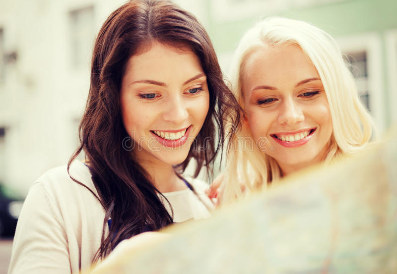 Download Beautiful Girls Looking Into Tourist Map In City Stock Photo - Image: 39811504