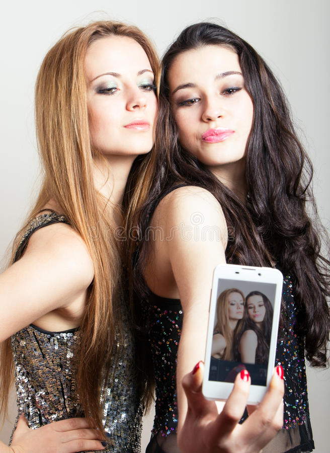 Download Beautiful Girls Making A Self Portrait With Mobile Stock Image - Image: 40020481