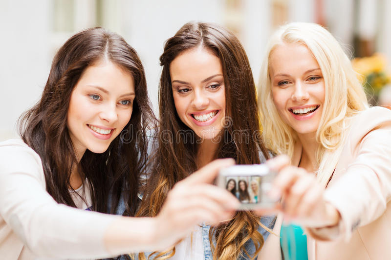 Download Beautiful Girls Taking Picture In Cafe In City Stock Photo - Image: 33078928