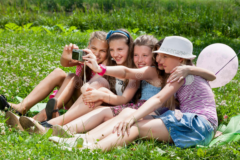 Beautiful Girls Taking Picture In City Park Stock Photo