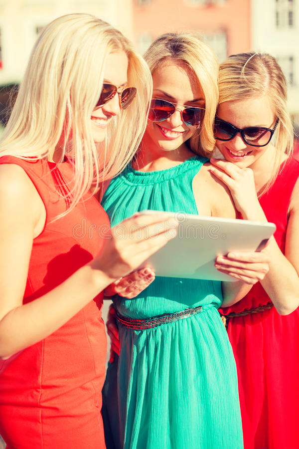 Beautiful Girls Toursits Looking Into Tablet Pc Stock Photo
