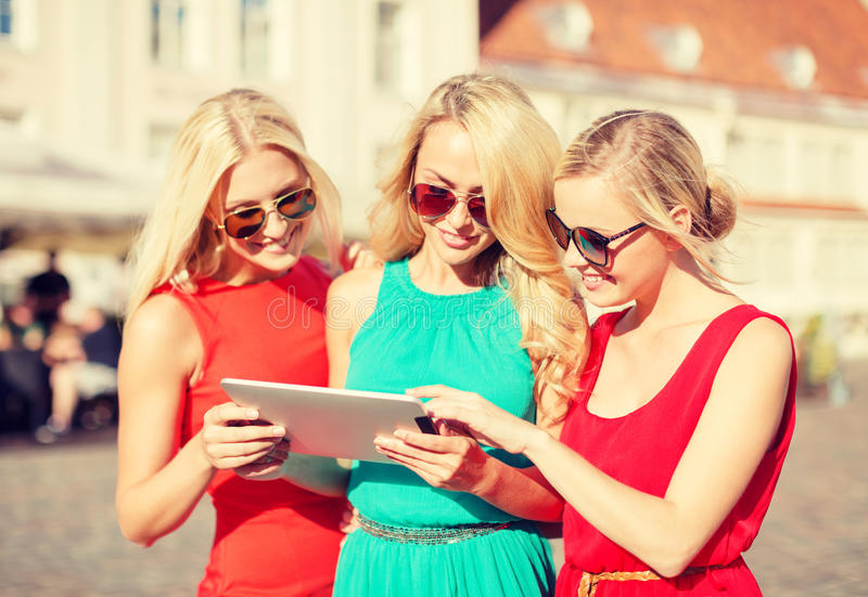 Download Beautiful Girls Toursits Looking Into Tablet Pc Stock Photo - Image: 43059056