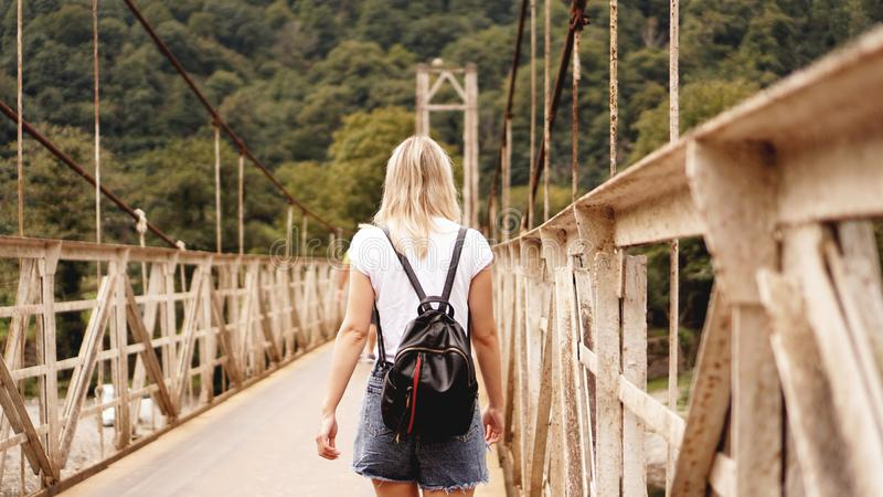 Beautiful girls traveling, walking on a bridge stock images