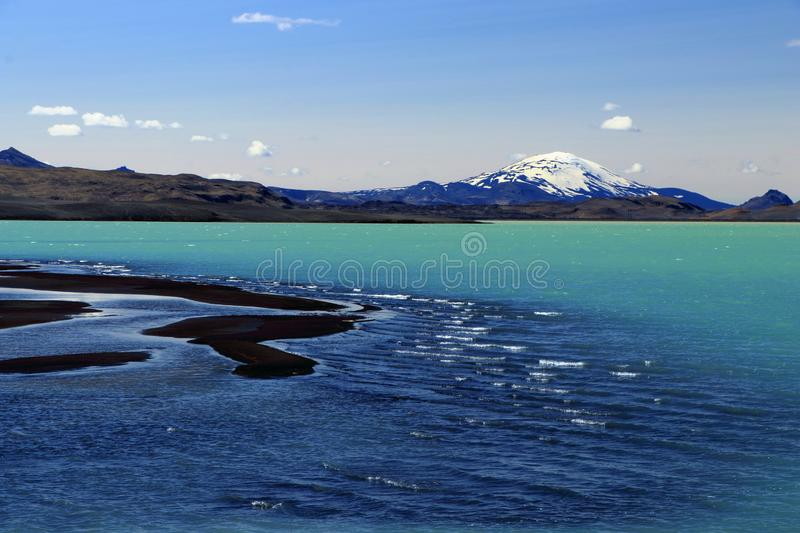 Beautiful Glacial Waters at Hrauneyjarlon with Hekla Volcano in the Background, Central Iceland stock images