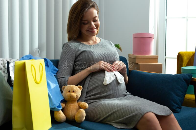 Feeling happy while preparing clothes for the newborn baby stock photography