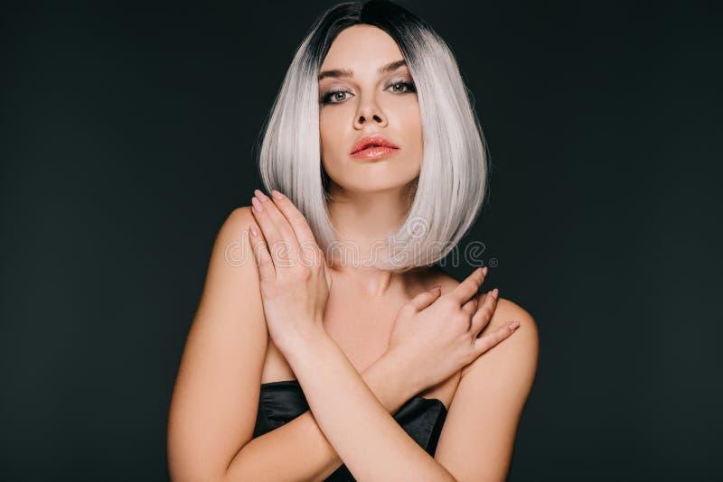 Beautiful glamor girl posing in grey wig, isolated stock photography