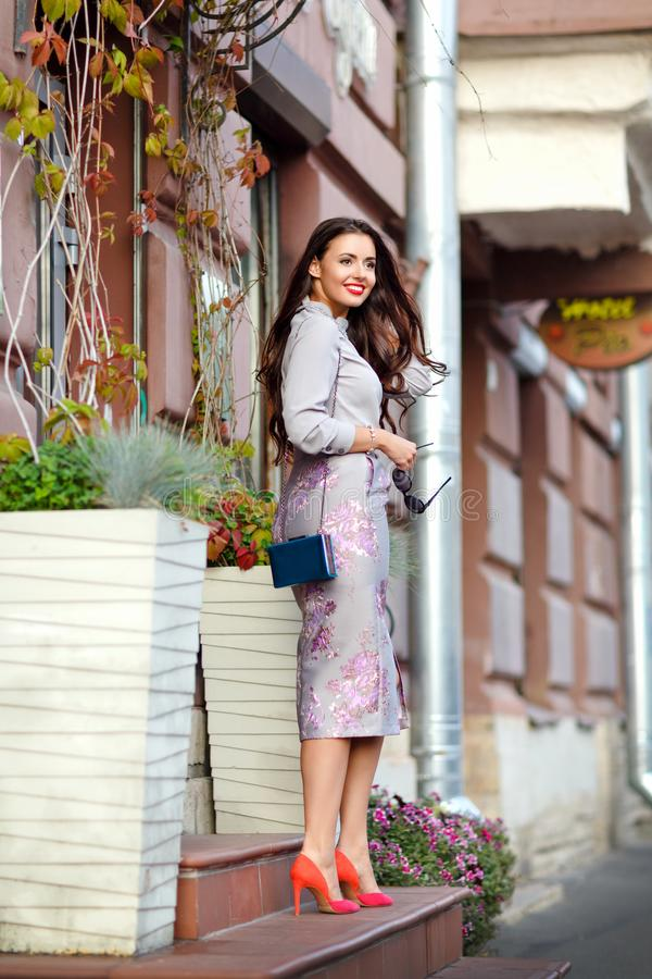 Beautiful, glamorous and stylish brunette girl in purple suit ag royalty free stock photos