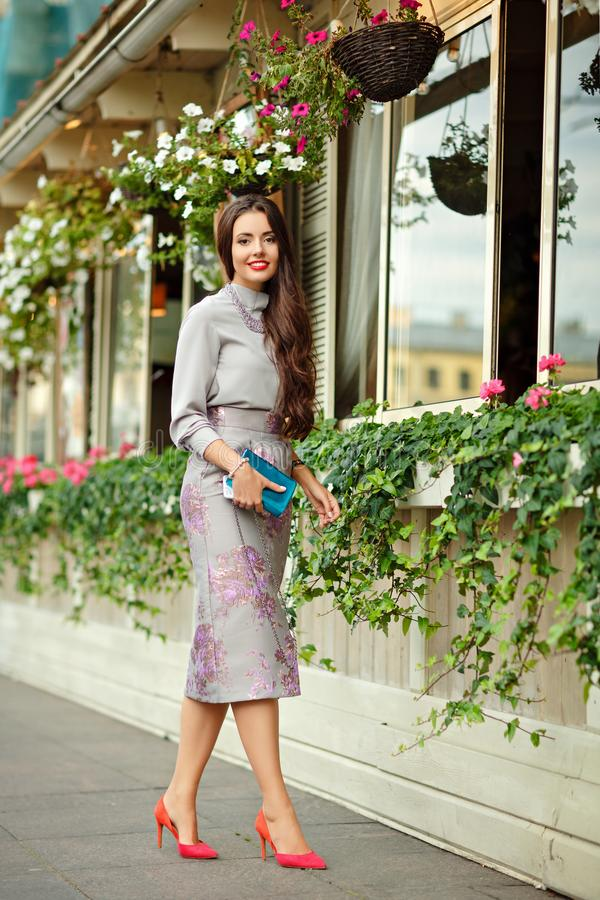 Beautiful, glamorous and stylish brunette girl in purple suit ag royalty free stock photography