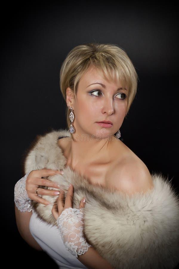 Beautiful glamorous woman in the studio royalty free stock photos