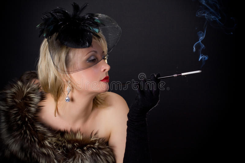 Beautiful glamorous woman in the studio royalty free stock images