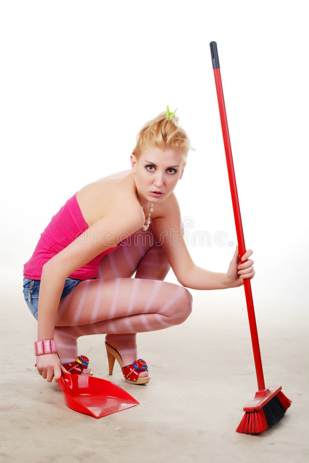 Beautiful glamour woman dustpan and broom stock images